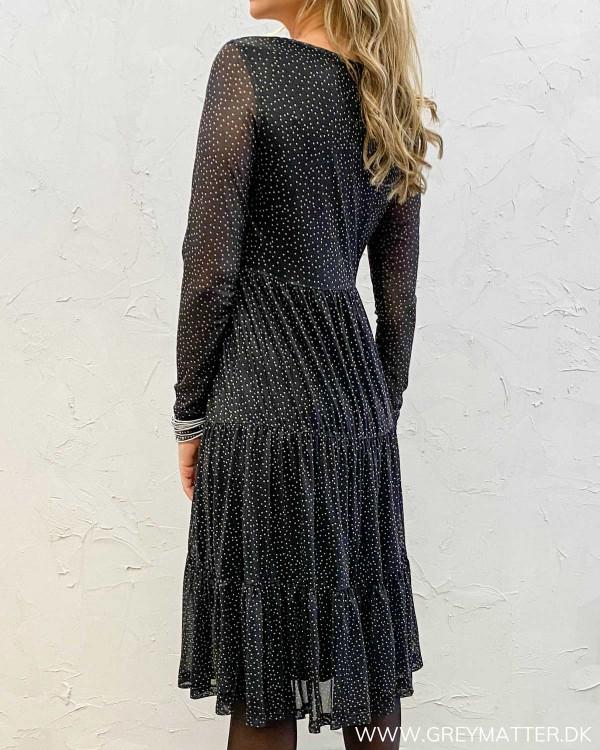 Prikkede kjoler med lange ærmer