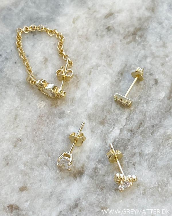 Fire flotte zirkon øreringe i belagt sterling sølv