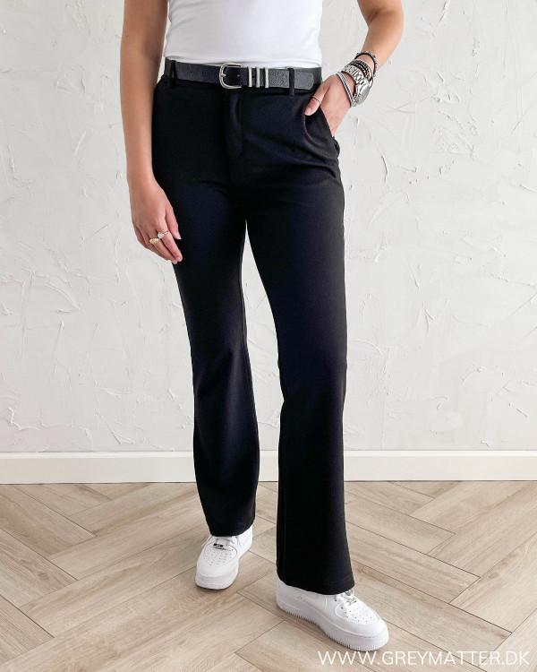 Sorte bukser til damer med vidde i benene