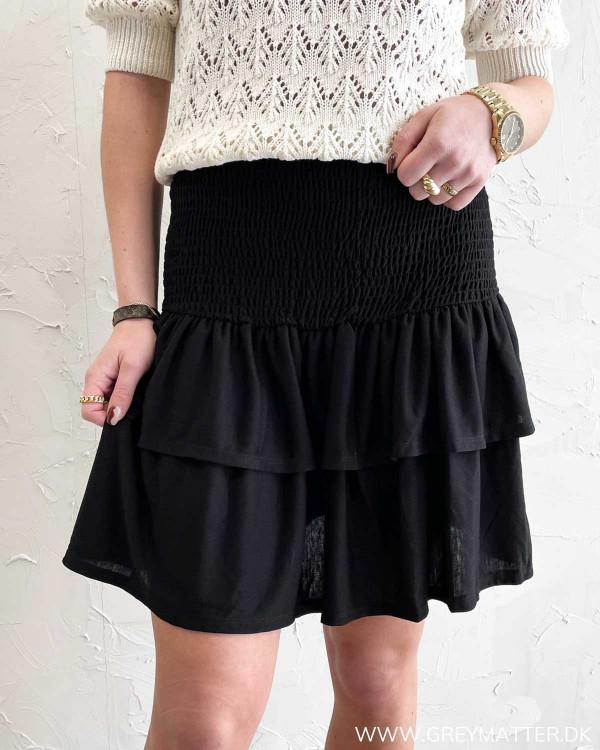 Sort kort nederdel