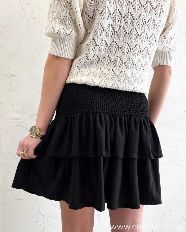 Kort nederdel i sort